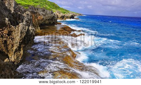 Jagged cliffs on the east side of the island of Guam near Pagat Point