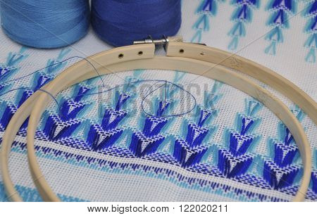 Detail of traditional Ukrainian embroidery towels in the wooden embroidery hoop