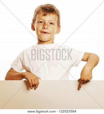 little cute boy holding empty shit to copyspace isolated on white background close up gesturing smiling
