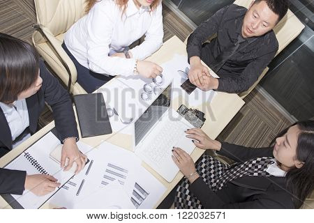 Image of  business people working at meeting.top view