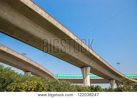 Shanghai China 03/16/2016 Elevated parallel roads with orange handrail and blues sunny sky