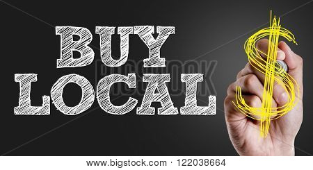 Hand writing the text: Buy Local