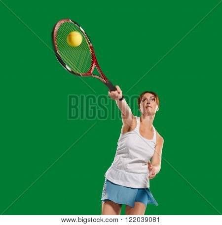 playing woman tennis and hitting the ball, in a green screen studio.Young woman with copy space on green screen chroma key