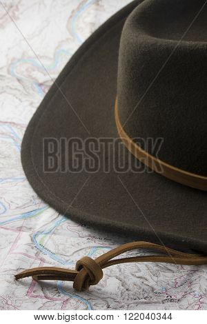 wool felt western hat on a topography map background