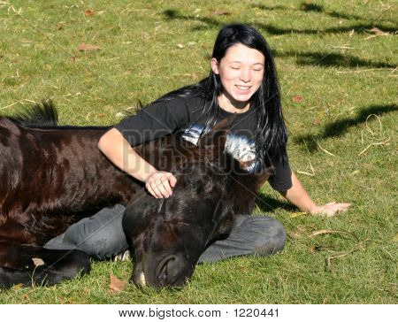 Smiling Teen And Horse