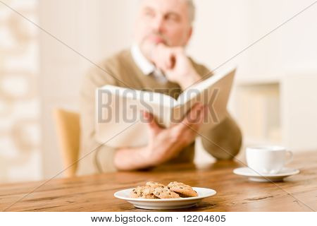 Senior Mature Man, Cookies At Wooden Table