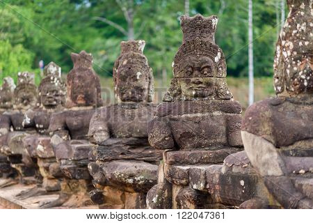 Siem Reap, Cambodia, 13 Nov 2015: Ancient statues carved out of stone at Angkor Thom kingdom.