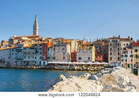 Rovinj, Croatia, 12 July 2012: Morning View On Old Town Rovinj From Harbor With Outdoor Restaurants,