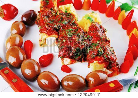 cheese cannelloni served with vegetables on white plate