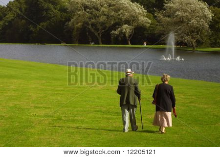 Elderly couple strolling in the park