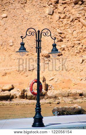 Lone wrought iron lantern on a sea berth