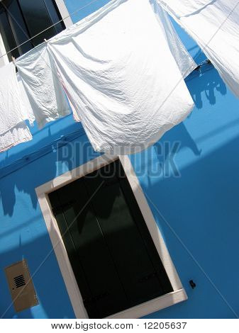 Washing outside of house on Burano island in Venice.
