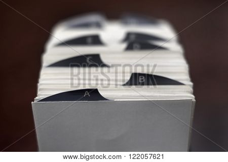 Closeup of index cards for business school or home organization organize names information