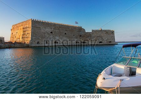 Heraklion old venetian harbour with old venetian fort and boat, Crete, Greece