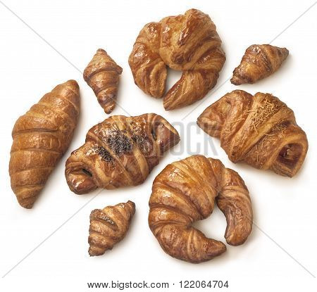 Different types of pastry and bakery on white background and a soft shadow. Clipping path on bakery.
