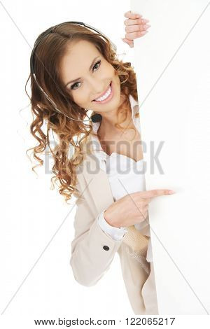 Call center woman pointing on empty banner.