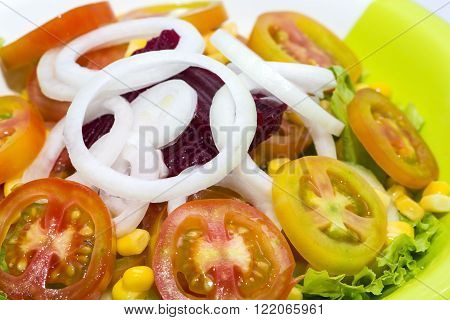 fresh vegetable salad tomato onion and lettuce