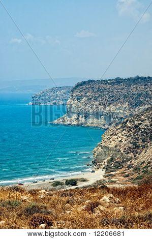 Kourion Coast With Blue Sea And Sky With Clouds.