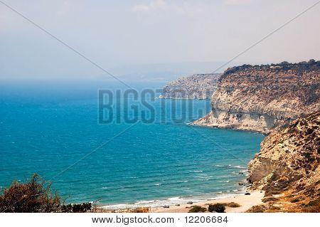 Kourion Coast With Blue Sea And Sky With Clouds