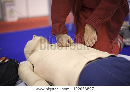 Cardiopulmonary resuscitation (CPR). First aid training. Heart massage. ** Note: Visible grain at 100%, best at smaller sizes