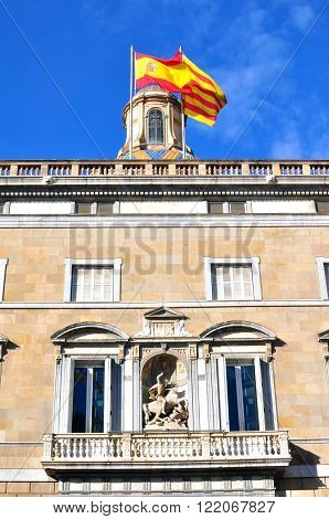 Building with spanish and catalan flags in Barcelona