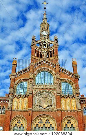 BARCELONA SPAIN - DECEMBER 18: Facade of Hospital de la Santa Creu in Barcelona on December 18 2014. Barcelona is the capital city of Catalonia Spain.