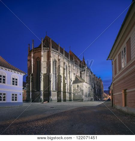 Brasov, Romania. Night image of the Black Church built in medieval times next to the Council Square in old city center of Brasov, Transylvania.