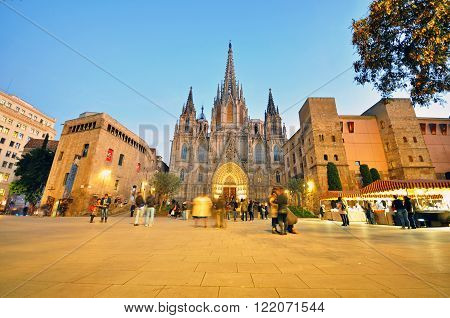 BARCELONA SPAIN - JANUARY 8: People on the Cathedral square in Barcelona old town on January 8 2015. Barcelona is the second largest city of Spain.