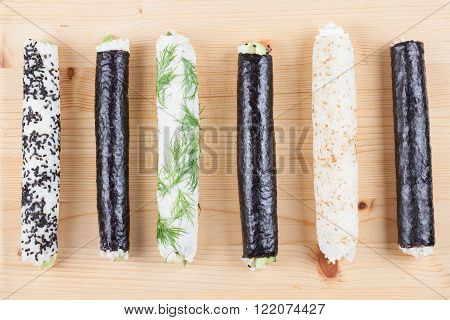 Homemade sushi rolls on a cutting board