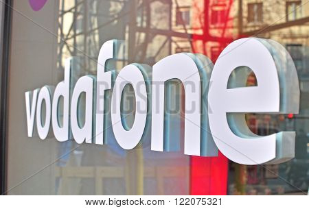 BARCELONA SPAIN - FEBRUARY 5: Logo of Vodafone company in the shop in Barcelona on February 5 2015. Vodafone is a British multinational telecommunications company.