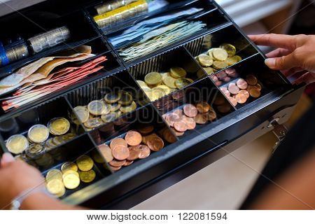 Open cash till containing Euros