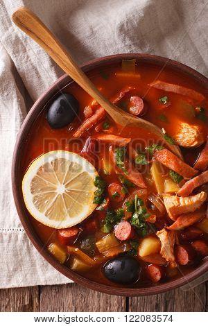 Solyanka - Russian Meat Soup In Bowl Closeup Vertical Top View