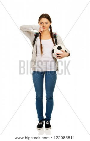 Young woman with foot ball.