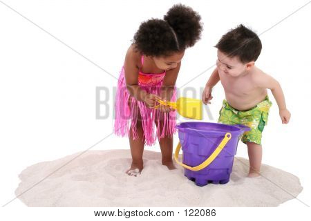 Adorable Toddlers Playing In The Sand