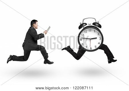 Man using tablet and running after alarm clock of running legs isolated on white background.