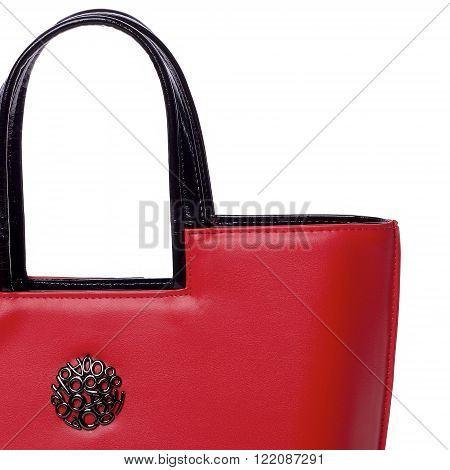 closeup photo of part of nice pretty red woman bag on hand with black patern button in the middle fashion casual accesssories on white background