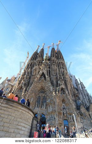 Barcelona, Spain - November 10, 2015: Basilica Sagrada Familia with Nativity facade. The church is designed by architect Antoni Gaudi and is still under construction. 