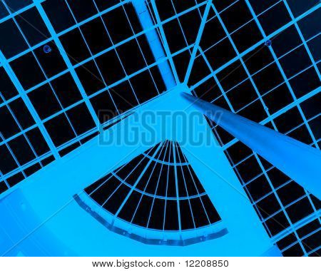 View of skylight windows in shopping mall (negative image in blue)