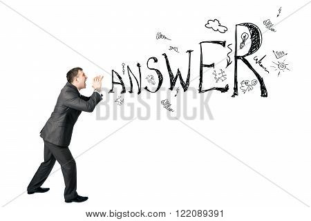 Businessman shouting word answer on white background
