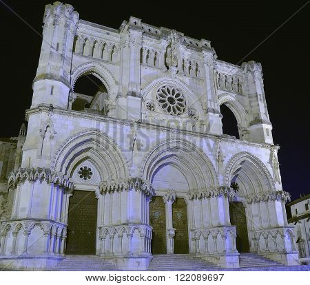 View on medieval white cathedral in Spain at night time