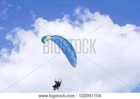JUMEIRAH BEACH RESIDENCE, DUBAI, UAE - NOVEMBER 22, 2015: Parachutist, skydiving over Dubai beach