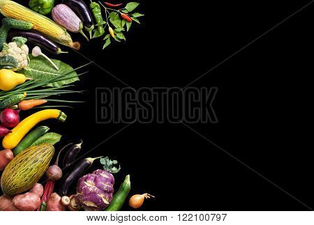 Deluxe Organic food background. Food photography different fruits and vegetables isolated black background. Copy space. High resolution product