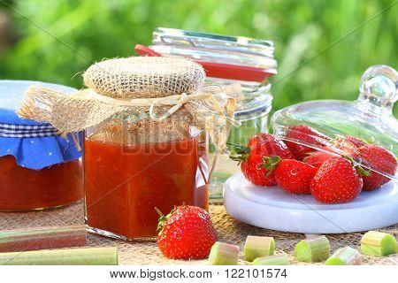 Strawberry rhubarb jam on old garden table