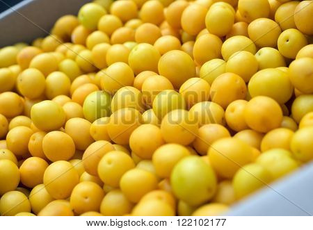 Yellow cherry plums in basket close-up. Selective focus.