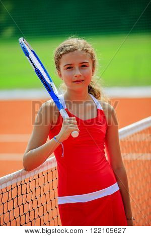 Tennis - beautiful young girl tennis player on the tennis court