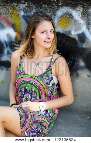 Beautiful Young Girl Sitting On The Pavement In A Dress. The Concept Of Reverie, Dreams