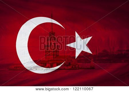 Turkish flag with view of The Maidens Tower also known as Leander's Toweri n Bosphorus strait seen in background, Istanbul, Turkey