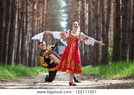 Couple of dancers in russian traditional costumes