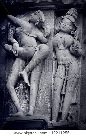 Stone carved erotic bas relief in Hindu temple in Khajuraho India. Unesco World Heritage Site