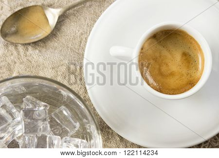 Espresso with ice cold water on wooden table